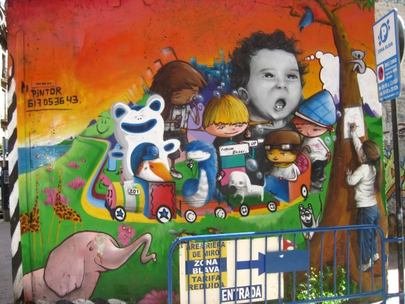 Cool graffiti. That little girl on the right is not real like I thought.